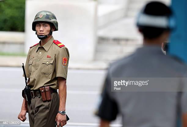 North Korean soldiers looks on as South Korean and United Nation officials visit after attending a ceremony to commemorate the 62nd Anniversary of...