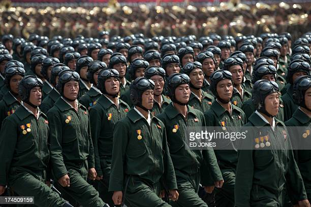 North Korean soldiers march during a military parade past Kim Il-Sung square marking the 60th anniversary of the Korean war armistice in Pyongyang on...
