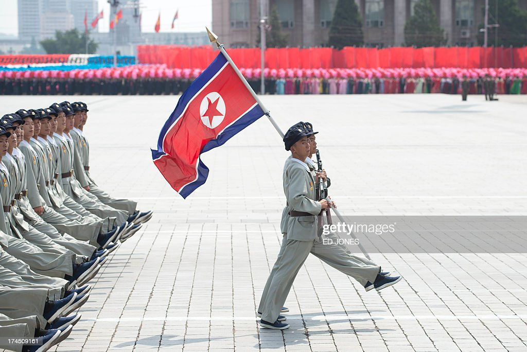North Korean soldiers march during a military parade past Kim Il-Sung square marking the 60th anniversary of the Korean war armistice in Pyongyang on July 27, 2013. North Korea mounted its largest ever military parade on July 27 to mark the 60th anniversary of the armistice that ended fighting in the Korean War, displaying its long-range missiles at a ceremony presided over by leader Kim Jong-Un. AFP PHOTO / Ed Jones
