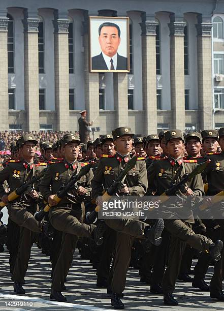 North Korean soldiers march during a military parade to mark 100 years since the birth of the country's founder Kim IlSung in Pyongyang on April 15...