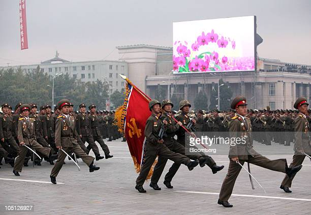 North Korean soldiers march in a parade commemorating the 65th anniversary of founding of the Workers' Party of Korea in Pyongyang North Korea on...