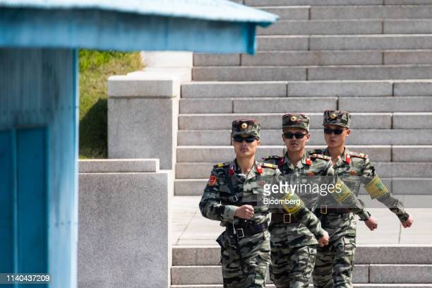 North Korean soldiers on the North Korean side of the border are seen marching towards the South Korean side of the border in the truce village of...
