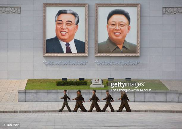 North Korean soldiers passing in front of Kim il Sung and Kim Jong il giant portraits on Kim il Sung square Pyongan Province Pyongyang North Korea on...