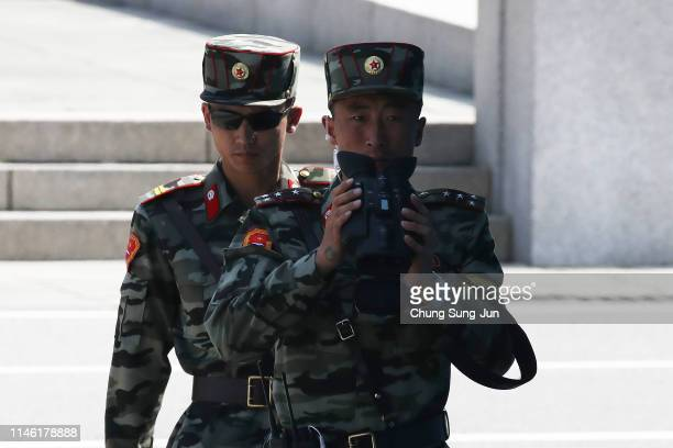 North Korean soldiers patrol at the truce village of Panmunjom inside the demilitarized zone separating the South and North Korea on May 01 2019 in...