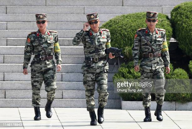North Korean soldiers patrol at the truce village of Panmunjom inside the demilitarized zone separating the South and North Korea on May 01, 2019 in...