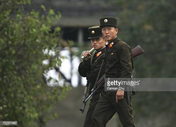 North Korean soldiers patrol on the banks of the Yalu River in the North Korean town of Sinuiju opposite the Chinese border city of Dandong October...