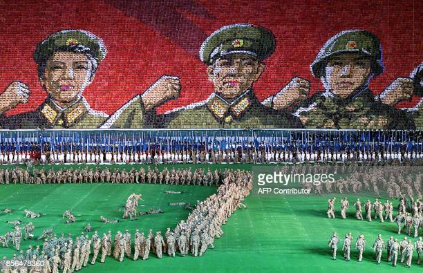 North Korean soldiers perform at the May Day Stadium as some 25000 cardchoreographers present an image of military might 23 October 2000 in Pyongyang...