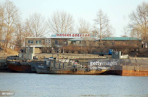 North Korean soldiers repair a boat outside a military barracks on the banks of the Yalu River near the North Korean town of Sinuiju opposite Chinese...