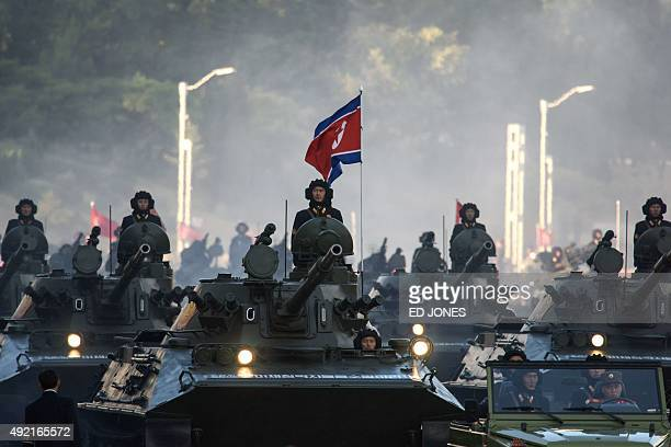 North Korean soldiers ride atop armoured vehicles during a mass military parade at Kim IlSung square in Pyongyang on October 10 2015 North Korea was...