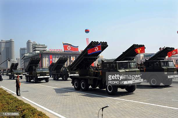 North Korean soldiers ride on the back of MLRS vehicles during a military parade to mark 100 years since the birth of the country's founder Kim...