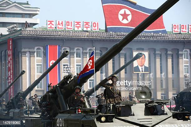 North Korean soldiers salute during a military parade to mark 100 years since the birth of the country's founder Kim IlSung in Pyongyang on April 15...