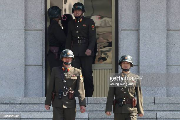 North Korean soldiers stand guard at the border village of Panmunjom between South and North Korea at the Demilitarized Zone on April 18 2018 in...