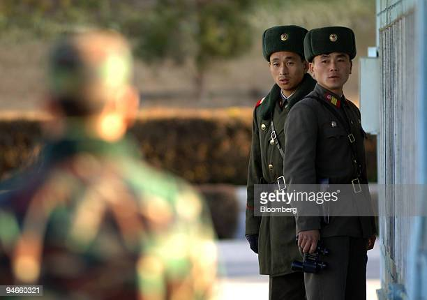 North Korean soldiers stand guard at the Joint Security Area of the Demilitarized Zone in the truce village of Panmunjom north of Seoul South Korea...