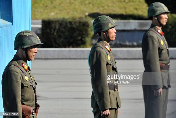 North Korean soldiers stand guard at the truce village of Panmunjom between North and South Korea on October 18 as the USled United Nations command...