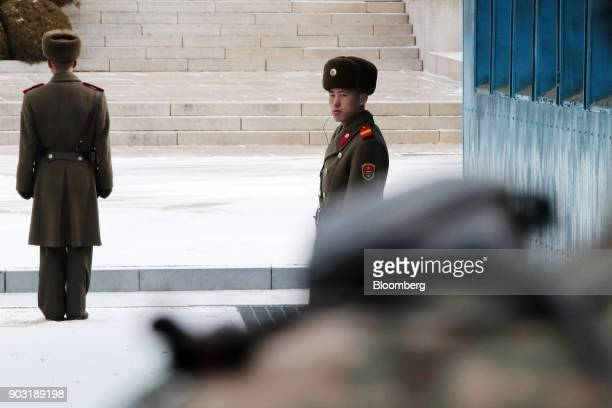North Korean soldiers stand guard at the truce village of Panmunjom in the Demilitarized Zone in Paju South Korea on Tuesday Jan 9 2018 North Korea's...