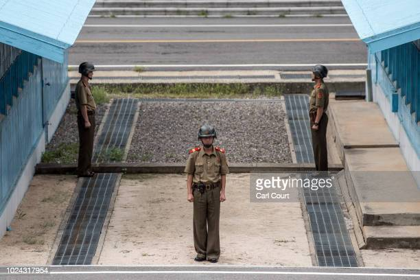 North Korean soldiers stand guard on the North Korean side of the Joint Security Area in the demilitarised Zone on August 24 2018 in Kaesong North...