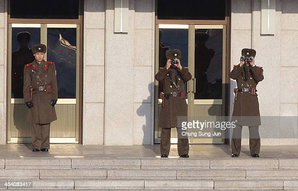 North Korean soldiers stand guards as US Vice President Joe Biden visit at Panmunjom on December 7 South Korea Vice President Biden has been visiting...