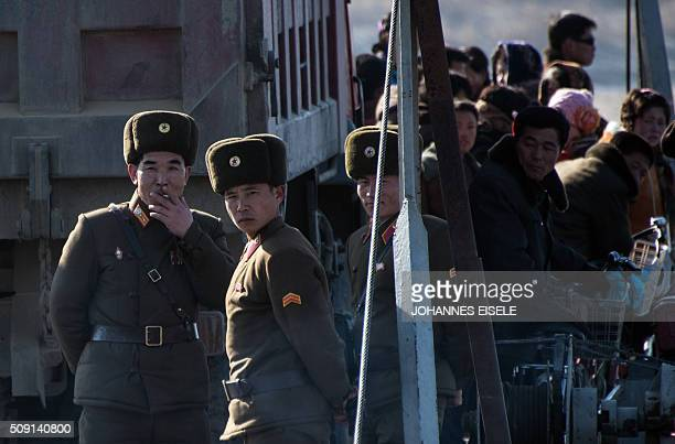 North Korean soldiers stand on a boat on the Yalu River in the North Koreantown of Sinuiju as seen from across the river from the Chinese border town...