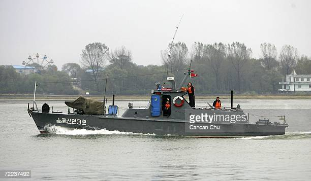 North Korean soldiers stand onboard a North Korean patrol boat along the Yalu River near the North Korean town of Sinuiju opposite the Chinese border...