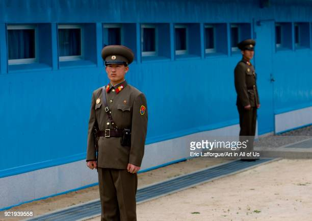 North Korean soldiers standing in front of the United Nations conference rooms on the demarcation line in the Demilitarized Zone, North Hwanghae...