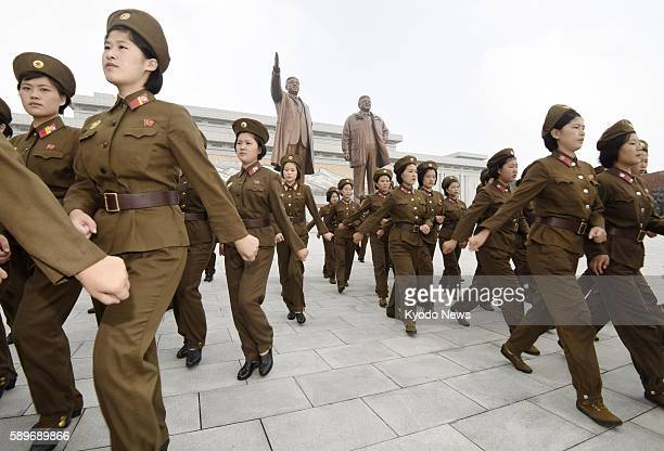 North Korean soldiers visit Mansudae hill in Pyongyang to offer flowers at bronze statues of former North Korean leaders Kim Il Sung and Kim Jong Il...