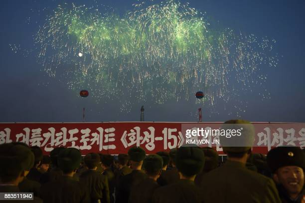 North Korean soldiers watch a fireworks display put on to celebrate the North's declaration on November 29 it had achieved full nuclear statehood,...