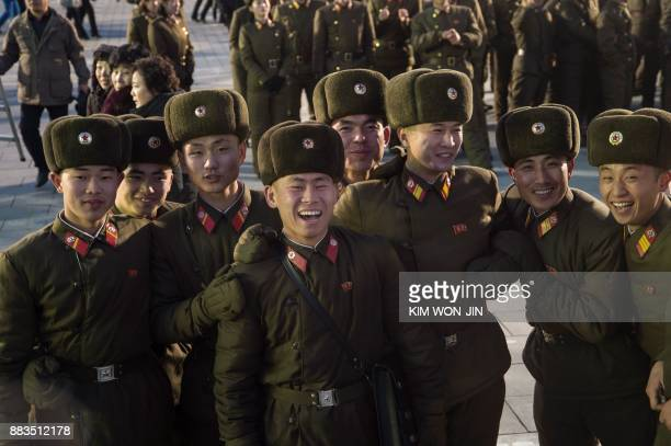TOPSHOT North Korean soldiers watch a fireworks display put on to celebrate the North's declaration on November 29 it had achieved full nuclear...