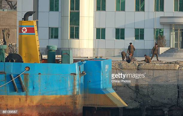 North Korean soldiers work on the pavement outside a military barracks on the banks of the Yalu River near the North Korean town of Sinuiju opposite...