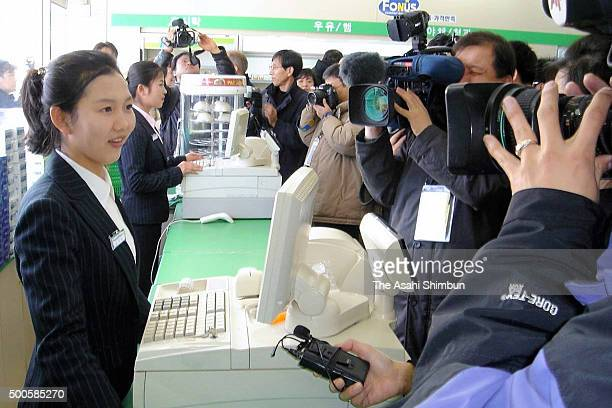 North Korean staffs of convenience store 'Family Mart' are interviewed on February 1 2006 in Kaesong North Korea