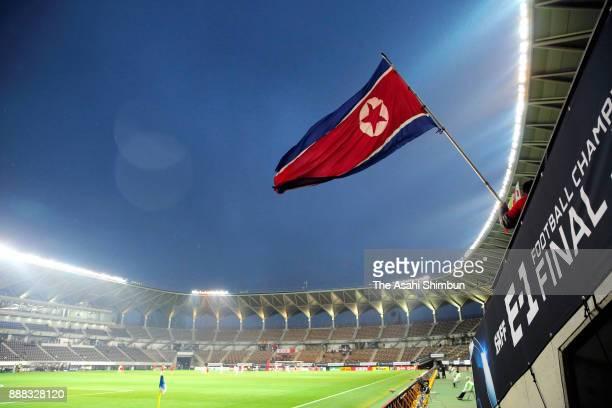 North Korean supporter waves the national flag prior to the EAFF E-1 Women's Football Championship between China and North Korea at Fukuda Denshi...
