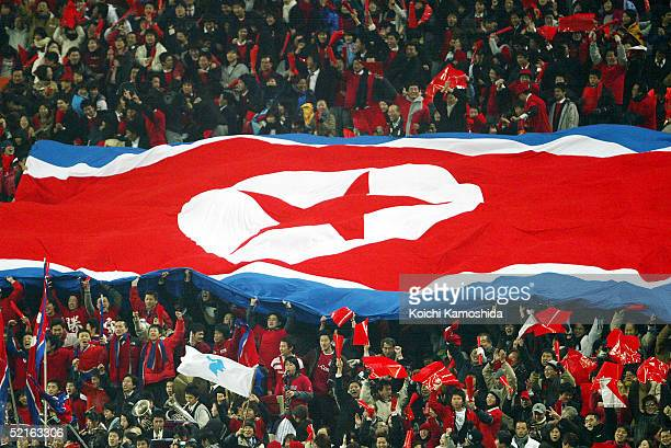 North Korean supporters enjoy the atmosphere during the 2006 FIFA World Cup Asian qualifying match between Japan and North Korea at Saitama Stadium...