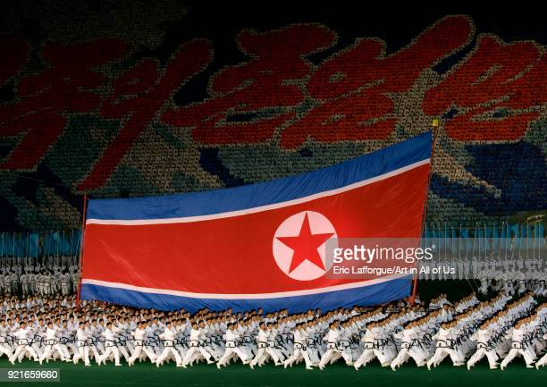 North Korean taekwondo team in front of a giant flag during the Arirang mass games in may day stadium Pyongan Province Pyongyang North Korea on...