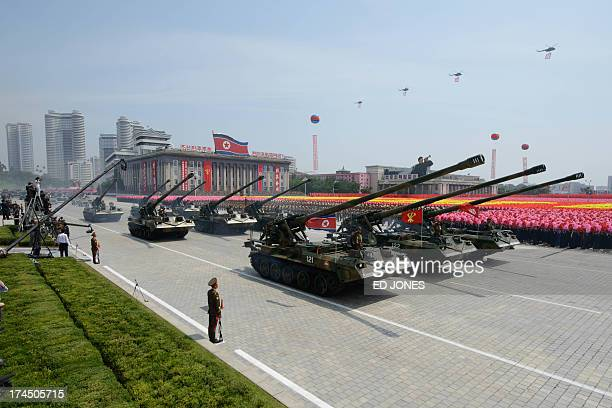 North Korean tanks pass through Kim IlSung square as helicopters fly above during a military parade marking the 60th anniversary of the Korean war...