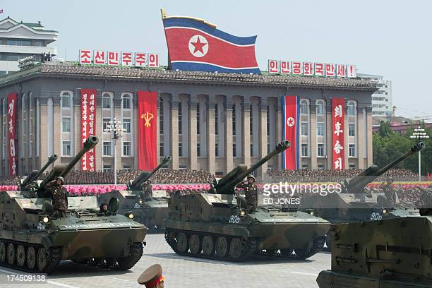 North Korean tanks take part in a military parade past Kim IlSung square marking the 60th anniversary of the Korean war armistice in Pyongyang on...