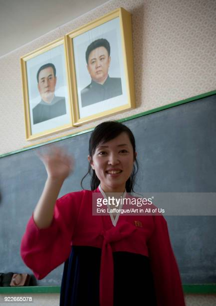 North Korean teacher under the offcial portraits of the Dear Leaders in Kwangbok school Pyongan Province Pyongyang North Korea on April 29 2010 in...