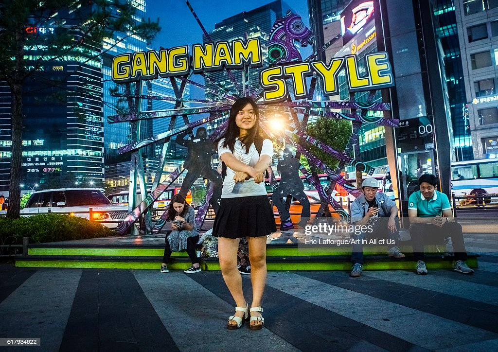 North korean teen defector in front of a gangnam style logo dancing like psy, National capital area, Seoul, South korea : News Photo