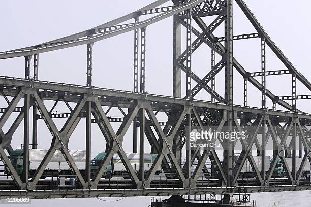 North Korean Vehicles line up on the China-North Korea Friendship Bridge over the Yalu River as they wait for inspection by Chinese paramilitary...