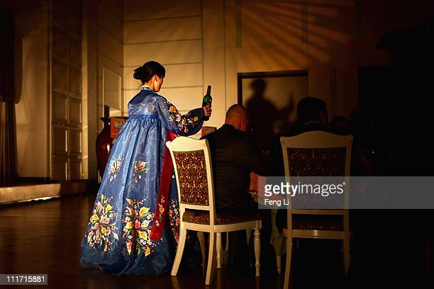 North Korean waitresses distribute beverage and food during a official reception on April 2 2011 in Pyongyang North Korea Pyongyang is the capital...