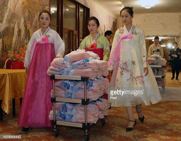 North Korean waitresses wearing traditional cloths 'hanbok' prepare for lunch during a separated family reunion meeting at the Mount Kumgang resort...