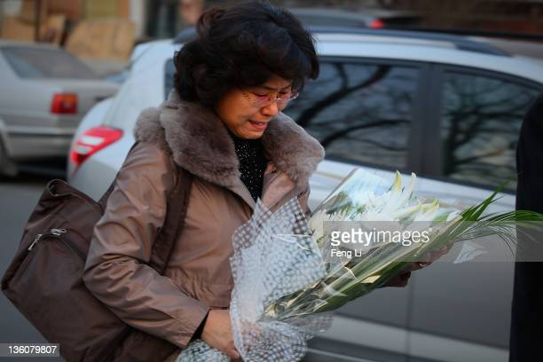 North Korean woman cries as she arrives at the North Korea embassy to mourn the death of North Korean leader Kim Jongil on December 19 2011 in...
