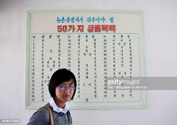 North korean woman in front of a village shop hamhung North Korea on September 12 2012 in Hamhung North Korea