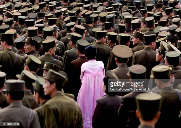 North Korean woman in pink chosonot in the middle of soldiers Pyongan Province Pyongyang North Korea on April 13 2008 in Pyongyang North Korea