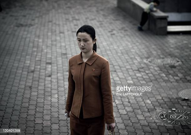 North Korean woman in Pyongyang North Korea It is very surprising when you arrive in North Korea to see all the people dressed with the same kind of...