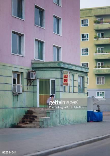 North Korean woman using mobile phone in the street Pyongan Province Pyongyang North Korea on September 9 2011 in Pyongyang North Korea
