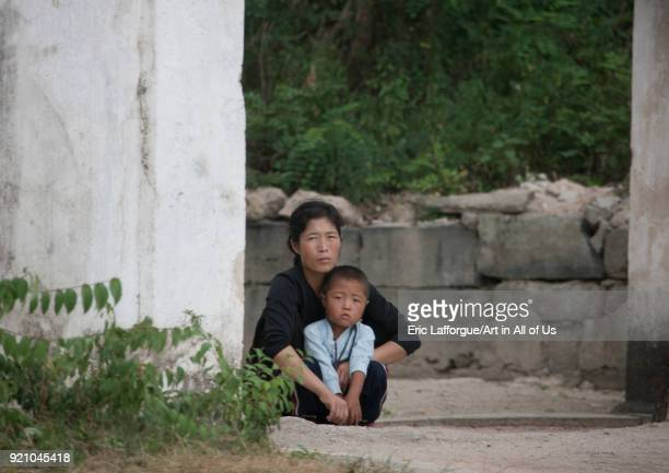 North Korean woman with her child in the street, North Hwanghae Province, Kaesong, North Korea on September 11, 2011 in Kaesong, North Korea.
