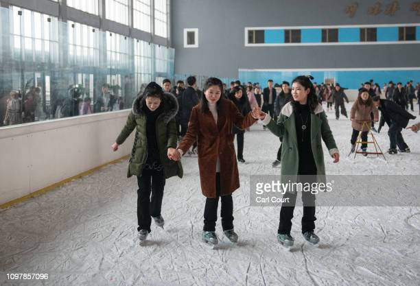 North Korean women hold hands as they skate together at an ice skating rink on February 06 2019 in Pyongyang North Korea US President Donald Trump...