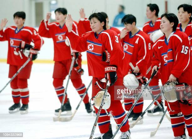 North Korean women ice hockey players wave to supporters after finishing their first match against Kazakhstan in the Aomori winter Asian Games in...
