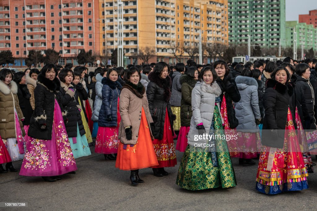 north-korean-women-in-traditional-korean-hanbok-dresses-wait-to-take-picture-id1097857288