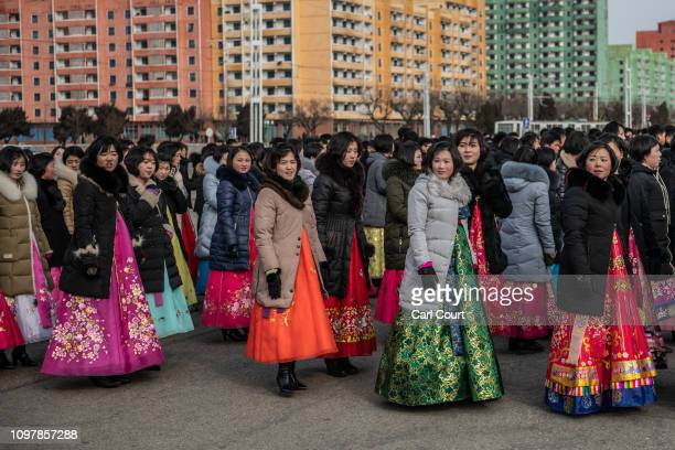 North Korean women in traditional Korean hanbok dresses wait to take part in a mass dance to mark the 71st anniversary of the Korean Peoples Army on...
