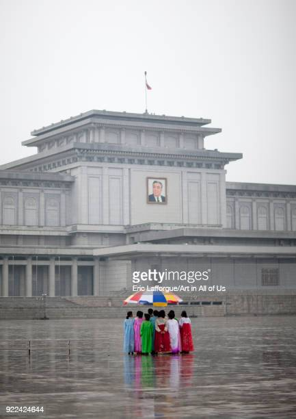 North Korean women under the rain in Kumsusan palace of the sun that serves as the mausoleum for Kim Ilsung and Kim Jongil Pyongan Province Pyongyang...